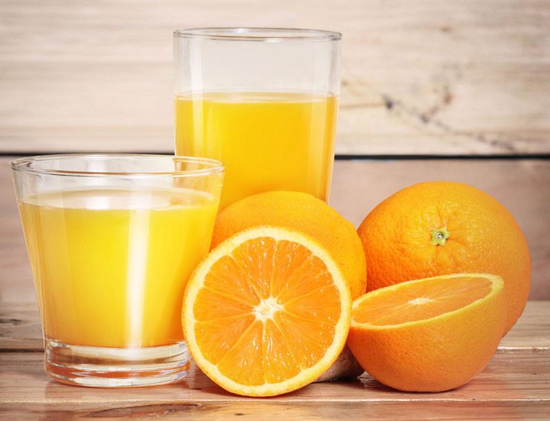 Mẹ bầu mang thai 3 tháng đầu nên uống nước cam